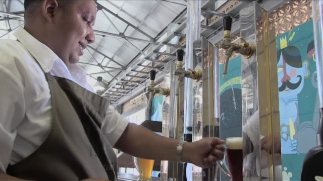 the opening of an austrian brewery in an old tobacco shop marks the beginning of havanas ambitious project to convert its five century old commercial... - traditionally austrian stock videos and b-roll footage