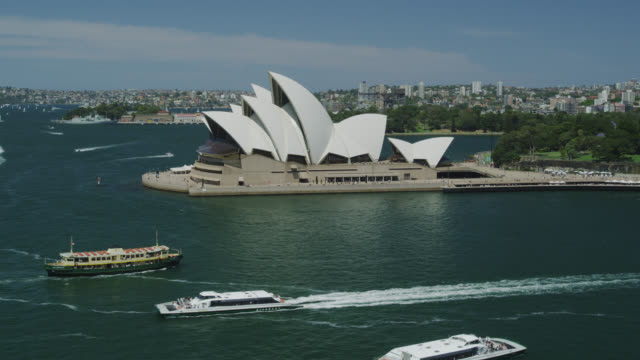 the opera house with ferry boats passing, sydney, new south wales, australia - real time stock videos & royalty-free footage
