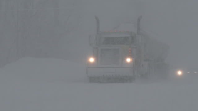 the operator of a fuel tanker drives in blizzard conditions in adams new york during a heavy lake effect snowstorm - scott mcpartland stock videos and b-roll footage