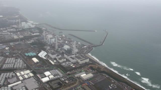 vídeos y material grabado en eventos de stock de the operator of the crippled fukushima daiichi nuclear plant began preparatory work to dismantle the no. 1 reactor building's cover as a first step... - nuclear energy