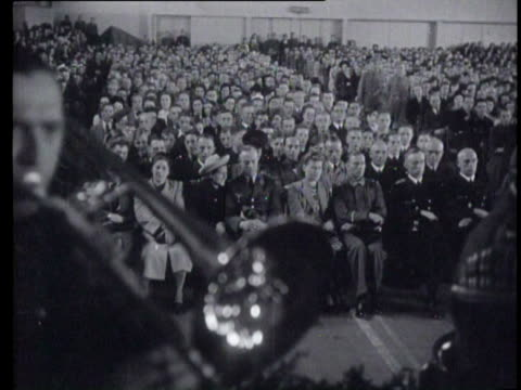 the orchestra of the german reichsarbeitsdienst led by the conductor and composer herms niel, plays in a with a crowd filled apollohal - composer stock videos & royalty-free footage