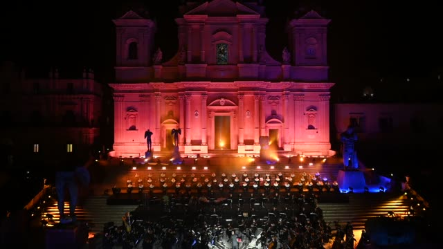 the orchestra plays before andrea bocelli performs on the steps of the noto cathedral on october 24, 2020 in noto, italy. andrea bocelli's concert... - andrea bocelli stock videos & royalty-free footage
