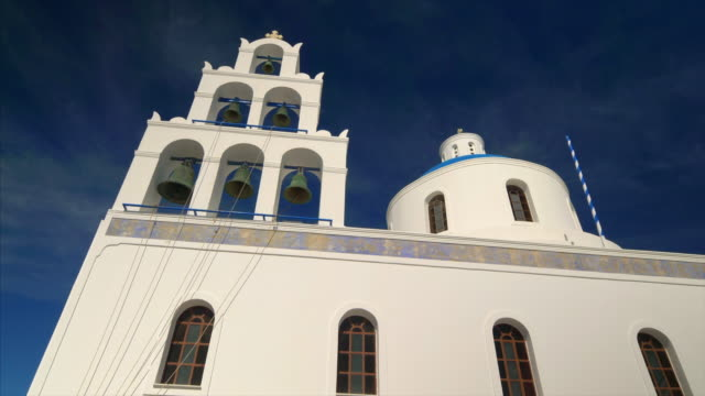 the orthodox church in oia, santorini, greece - oia santorini stock videos & royalty-free footage