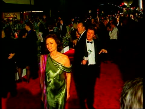 the oscars 1998; ext at night madonna arriving for post oscar party i/c jon landau intvwd - i feel fantastic cameron and wife posing for photocall - oscar party stock videos & royalty-free footage