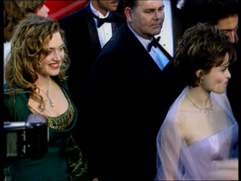 california hollywood kate winslett and helena bonhamcarter arriving for oscar ceremony minnie driver arriving cast of `the full monty' arriving - minnie driver stock videos and b-roll footage