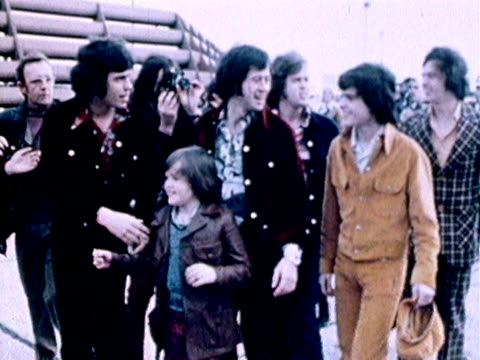 the osmonds wave to their fans as they arrive at heathrow airport for a tour of the uk 1972 - 1972 stock videos & royalty-free footage
