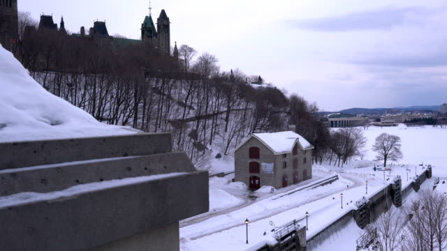 the ottawa locks on the rideau canal, located between parliament hill and the chateau laurier, leading out to the ottawa rive - parliament hill stock videos and b-roll footage