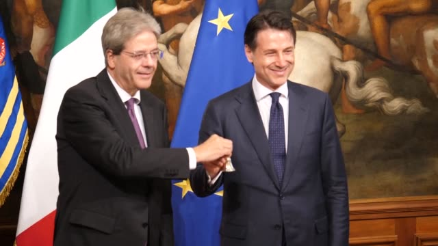the outgoing italian prime minister paolo gentiloni symbolically presents the new prime minister giuseppe conte on friday afternoon with the bell... - prime minister video stock e b–roll