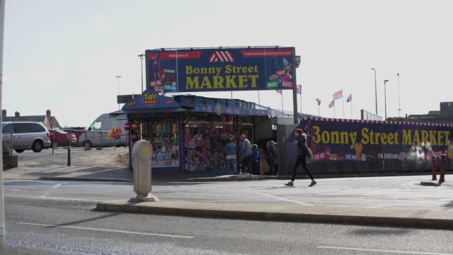 the outside of bonny street market as people walk by on october 20, 2020 in blackpool, england. lancashire has entered tier 3 of the government's... - cute stock videos & royalty-free footage