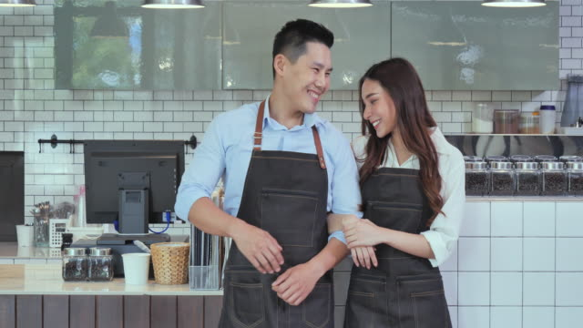 the owner of a couple who has succeeded in doing business in the coffee shop, coffee shop concept. - cafe culture stock videos & royalty-free footage