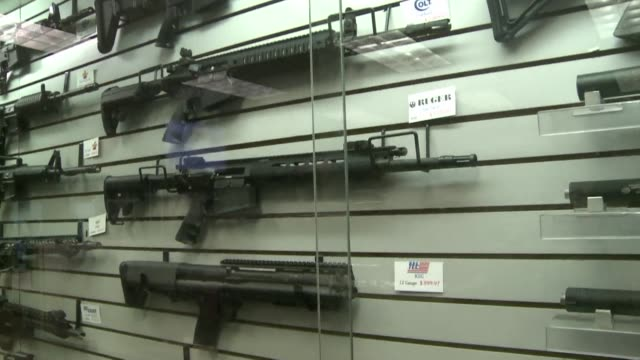 the owner of a gun shop and firing range near ferguson says sales have shot up in recent weeks as people seek to protect themselves from violent... - gun shop stock videos & royalty-free footage