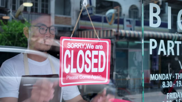 the owner of a small business shop came to closed the shop. - closing stock videos & royalty-free footage
