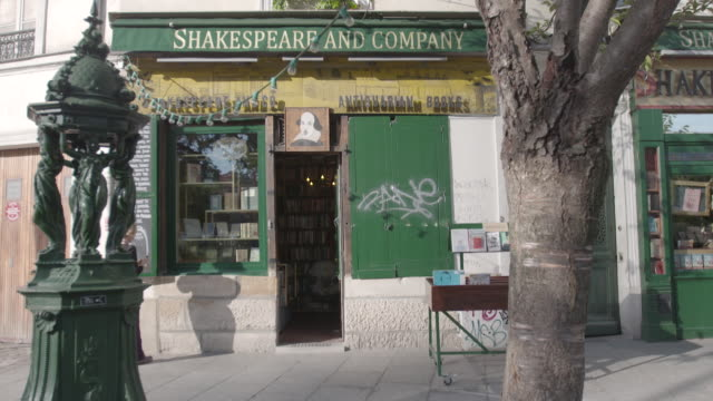 the owner of paris book shop 'shakespeare and company' opening up for a days trading - book shop stock videos & royalty-free footage