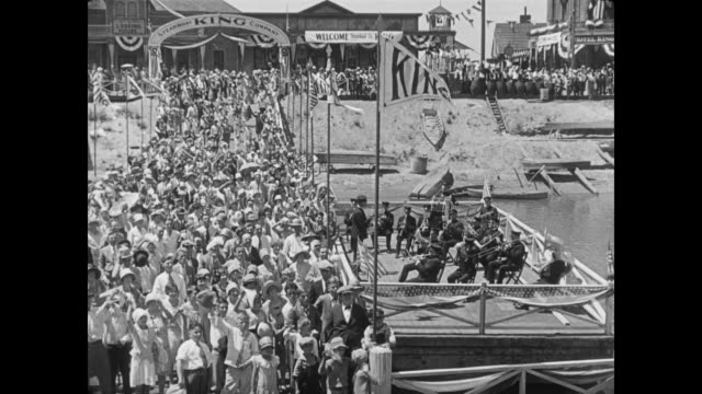 1928 the owner of steamboat king (tom mcguire ) speaks to the welcoming crowd on the dock - 1928 stock videos & royalty-free footage
