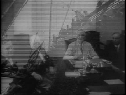 the pacific war council discusses war plans, including making offensive maneuvers in japan / men sitting around the table in the white house includes... - 1943 stock-videos und b-roll-filmmaterial