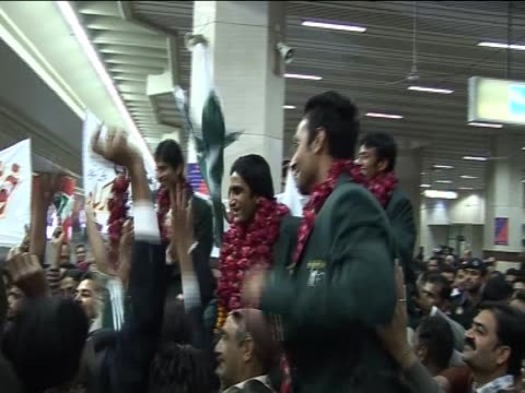the pakistan national hockey team celebrate at lahore aiport having won gold in the asian games and winning immediate qualification for the 2012... - national team stock videos & royalty-free footage