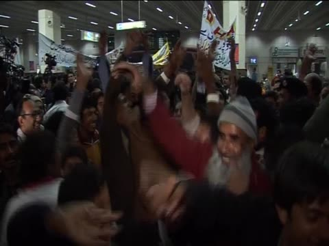 the pakistan national hockey team celebrate at lahore airport having won gold in the asian games and winning immediate qualification for the 2012... - national team stock videos & royalty-free footage