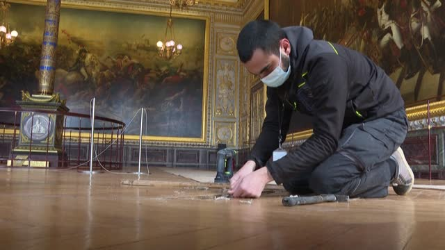 the palace of versailles may be closed for now but there is a hive of activity going on behind the closed gates from garden maintenance to renovation... - wooden floor stock videos & royalty-free footage