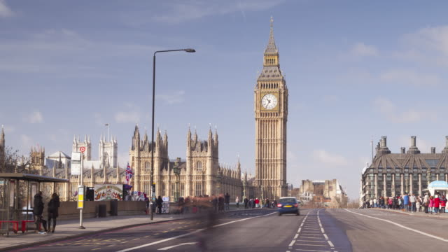 the palace of westminster and westminster bridge in london, england. - westminster bridge stock videos and b-roll footage