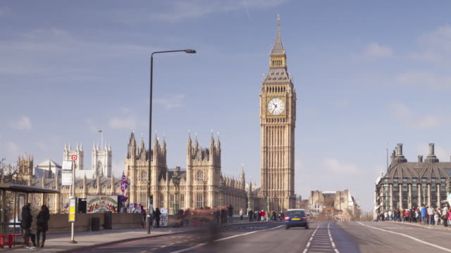 the palace of westminster and westminster bridge in london, england. - house of commons stock videos and b-roll footage