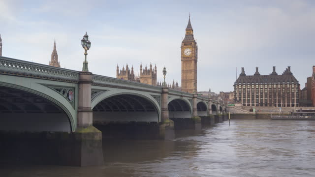 the palace of westminster and westminster bridge in london. - westminster bridge stock videos and b-roll footage