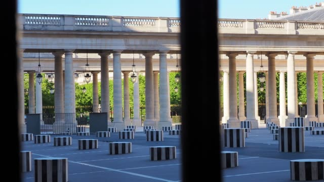 """the palais-royal garden and the """"colonnes de buren"""" are seen closed, on may 28, 2020 in paris, france. the coronavirus pandemic has spread to many... - architectural column stock videos & royalty-free footage"""