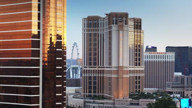 the palazzo and the venetian on the las vegas strip - drone shot - the palazzo las vegas stock videos & royalty-free footage