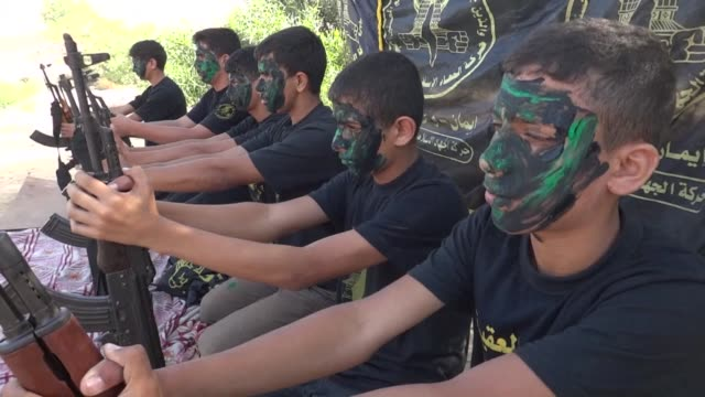 the palestinian group islamic jihad is providing combat training for boys as young as six as part of a two week summer camp in the city of rafah in... - jihad stock videos & royalty-free footage