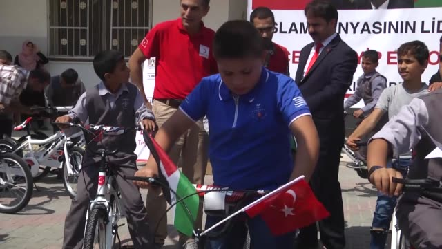the palestinian ministry of social affairs members distribute bicycles sent by turkish president recep tayyip erdogan as a gift to children at... - vessel part stock videos & royalty-free footage