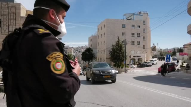 the palestinians announce a twoweek ban on tourists visiting cities and sites in the occupied west bank after the first suspected cases of... - palestinian territories stock videos & royalty-free footage