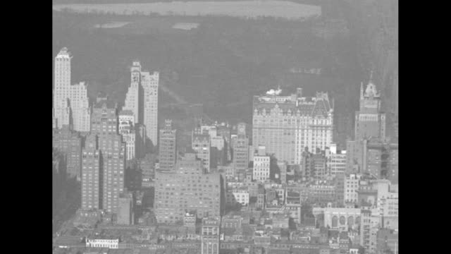 the panorama of manhattan seen from the empire state building, with views of the chrysler building, central park, and fifth avenue with traffic and... - shadow stock videos & royalty-free footage