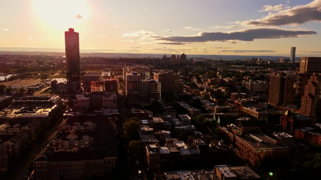 The panoramic video of the Jersey City from the rooftop, at the sunset. Static video, no camera motion