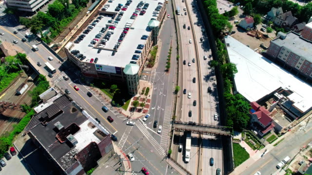 the panoramic video of the new rochelle downtown over the highway - american interstate stock videos & royalty-free footage