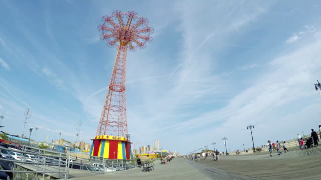 the parachute jump on the boardwalk at coney island. - coney island stock-videos und b-roll-filmmaterial