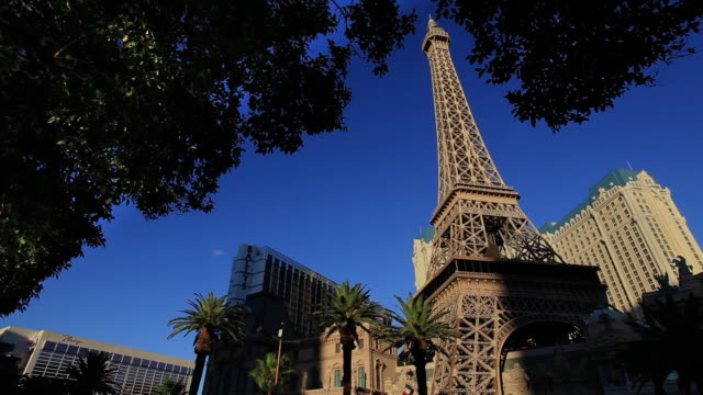 the paris casino features a replica of the eiffel tower. - replica eiffel tower stock videos & royalty-free footage