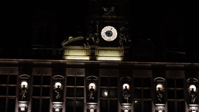 the paris city hall clock face reading the time of 9 pm, the start of the new curfew. the new curfew is from 9 p.m. to 6 a.m. in nine metropolises,... - orthographic symbol stock videos & royalty-free footage