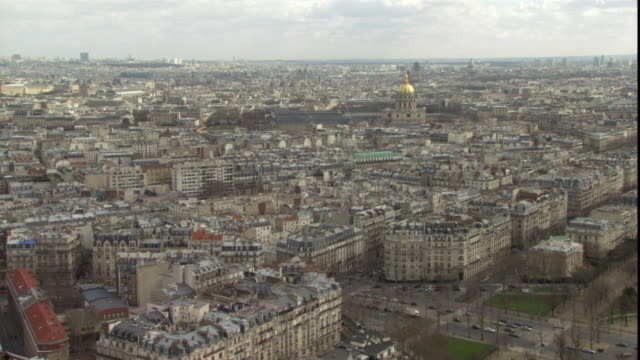 the paris cityscape is seen from a rooftop. - pantheon paris stock videos & royalty-free footage