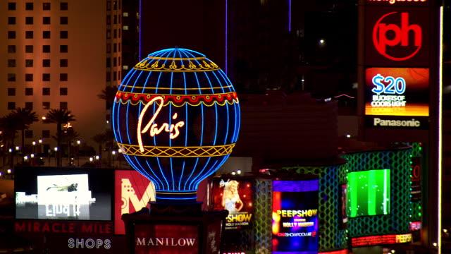 the paris hotel and caesars palace light up the las vegas, nevada sky at night. - paris las vegas stock videos & royalty-free footage