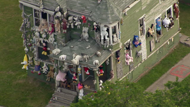 the party animal house, an abandoned house in detroit, covered with stuffed animals as part of the heidelberg project. - dollhouse stock videos & royalty-free footage