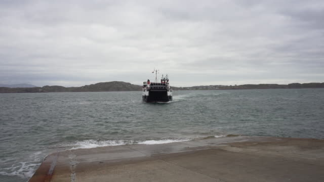 the passenger ferry arriving on the island of iona from mull - pilgrimage stock videos & royalty-free footage