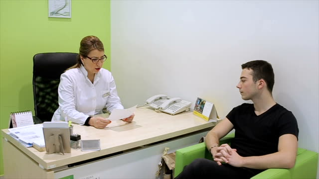 the patient talks to the doctor
