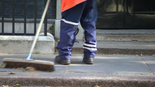 the pavement being swept outside the 10 downing street front door - downing street stock videos & royalty-free footage