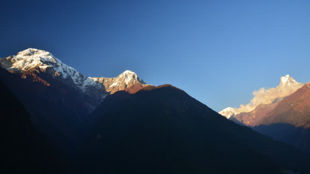 The peak of Annapurna South, Hinchuli and Machhapuchhre during sunset in Chhomrong, Nepal.