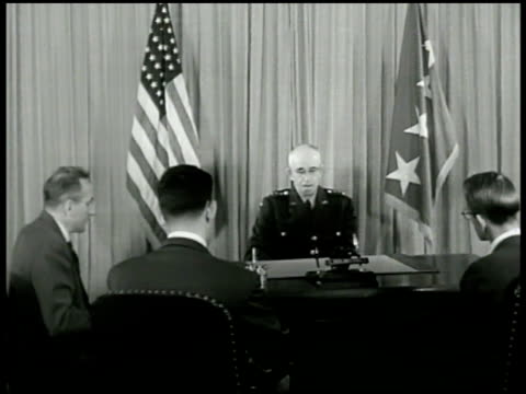the pentagon chairman of the joint chiefs of staff general omar bradley sitting at desk speaking sot to seated reporters saying depending on when a... - the pentagon stock videos & royalty-free footage