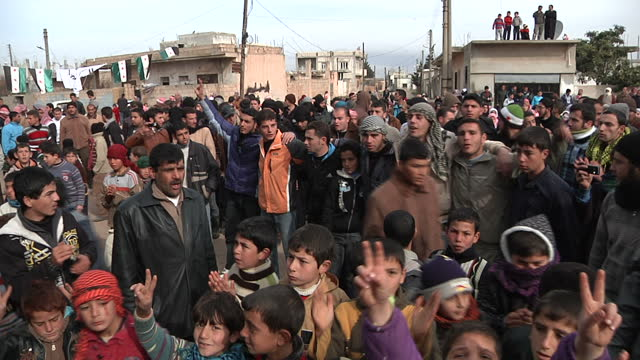 The people of Homs are under siege from Assad's forces Shows exterior shots people chanting against at anti Assad rally in Baba Amr on February 02...