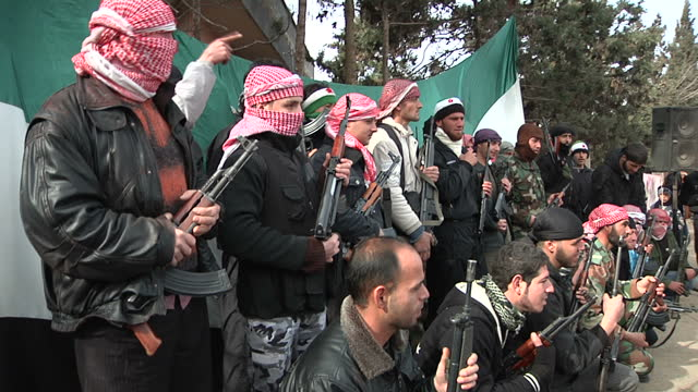the people of homs are under siege from assad's forces. shows exterior shots fsa fighters in group at rally in baba amr. on february 02, 2012 in... - arab spring stock videos & royalty-free footage