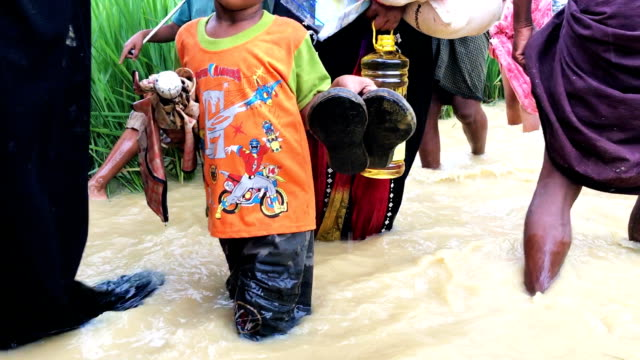 The people of Rohingya walk through muddy water in the sprawling refugee camp on October 5 2017 at Palongkhali Cox's Bazar Bangladesh Over a half a...