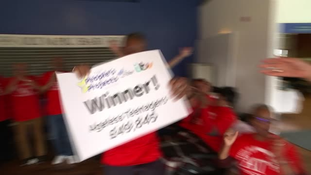 the people's projects 2019: winners revealed; england: london: ilford: int reporter opens envelop to reveal 'ageless teenagers charity as people's... - ilford stock videos & royalty-free footage