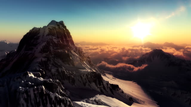 the perfect mountain aerial shot in sunset - snowcapped mountain stock videos and b-roll footage