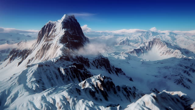 the perfect mountain aerial shot - snowcapped mountain stock videos and b-roll footage